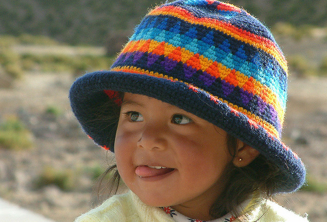 Cute young face from the Andes - Bolivian girl.