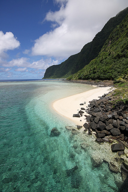 Turquoise water, green mountains and white sand in American Samoa