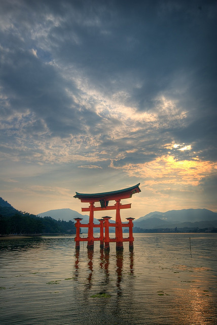 Torii of Itsukushima Shrine at sunset in Miyajima, Japan